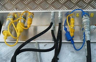 Hydraulic outlet for operation of tools. Operated by an on/off joystick as well as min/max tool speed.